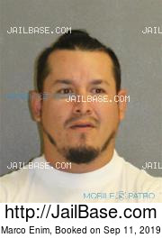 Marco Enim mugshot picture
